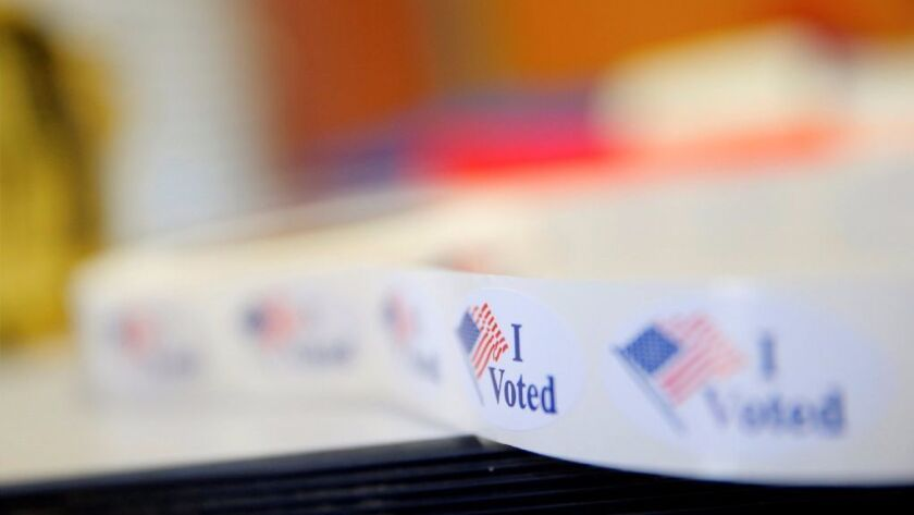 """""""I Voted"""" stickers are seen during early voting at West Charlotte Public Library in Charlotte, North Carolina October 20, 2016."""