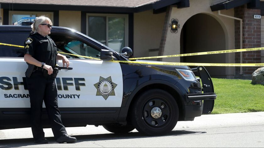"A Sacramento County sheriff's deputy stands guard on April 24, 2018, in front of the Citrus Heights home of Joseph James DeAngelo, the suspected ""Golden State Killer."" The house was recently sold."