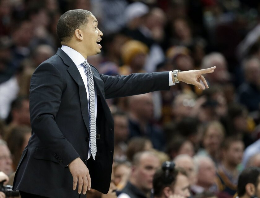 Cleveland Cavaliers head coach Tyronn Lue yells to players in the second half of an NBA basketball game against the Minnesota Timberwolves, Monday, Jan. 25, 2016, in Cleveland. The Cavaliers won 114-107. (AP Photo/Tony Dejak)