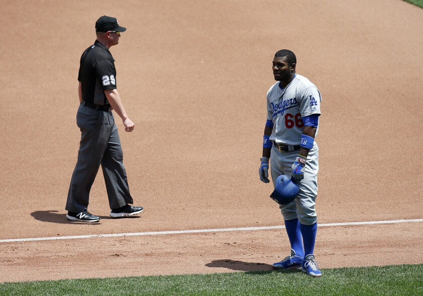 Dodgers outfielder Yasiel Puig (66) reacts after being called out at first base against the Pittsburgh Pirates on June 27.