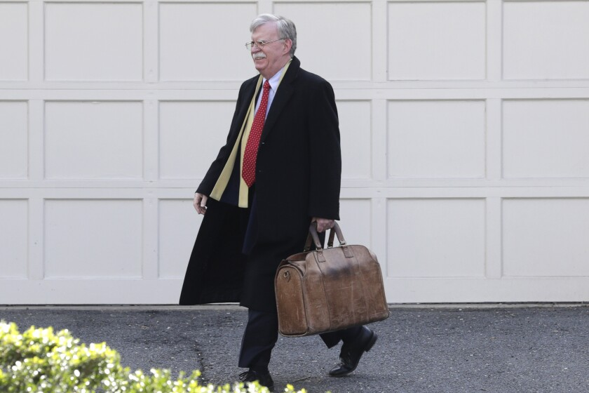 Former national security advisor John Bolton leaves his home in Bethesda, Md., on Jan. 28 while President Trump's impeachment trial was underway.
