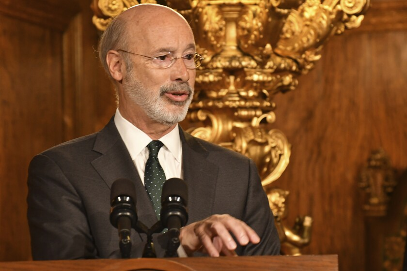 Pennsylvania Gov. Tom Wolf speaks to reporters during a news conference on his signing an executive order for his administration to start working on regulations to bring Pennsylvania into a nine-state consortium that sets a price and limits on greenhouse gas emissions from power plants, Thursday, Oct. 3, 2019 in Harrisburg, Pa. The move is part of Wolf's effort to fight climate change in the nation's fourth-biggest emitter of greenhouse gases. (AP Photo/Marc Levy)
