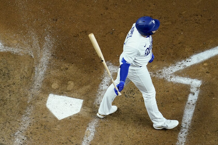Max Muncy walks away from the plate after striking out during the third inning of the Dodgers' 5-1 loss.