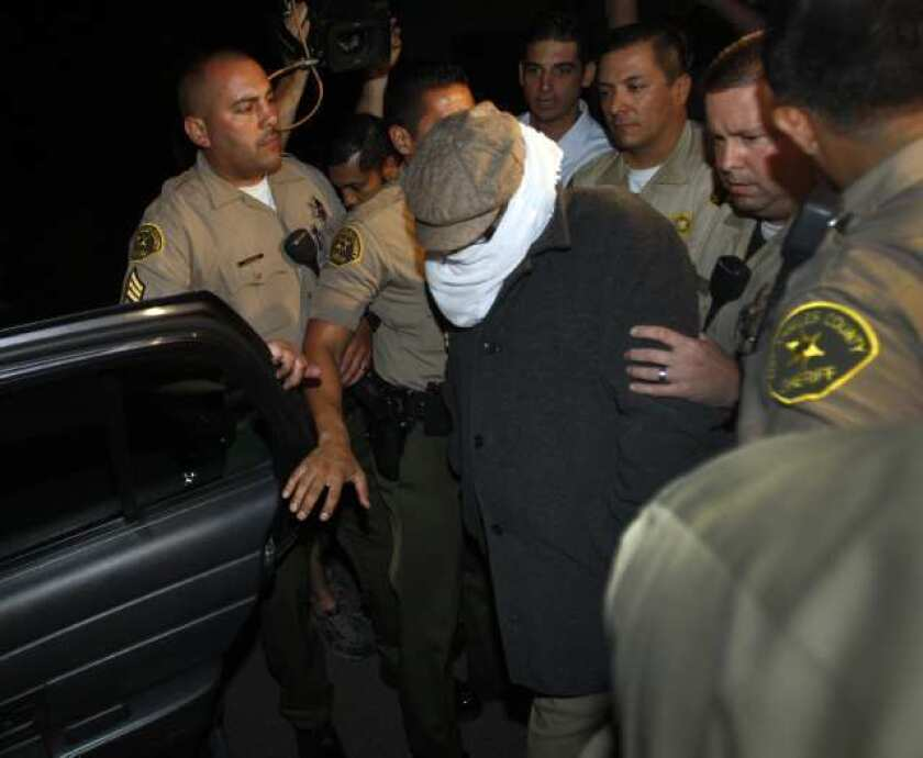Authorities take Mark Basseley Youssef into custody earlier this year.