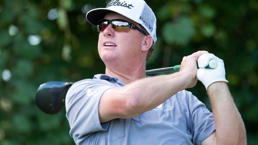Charley Hoffman watches his tee shot on the 16th hole during the third round of the Canadian Open go