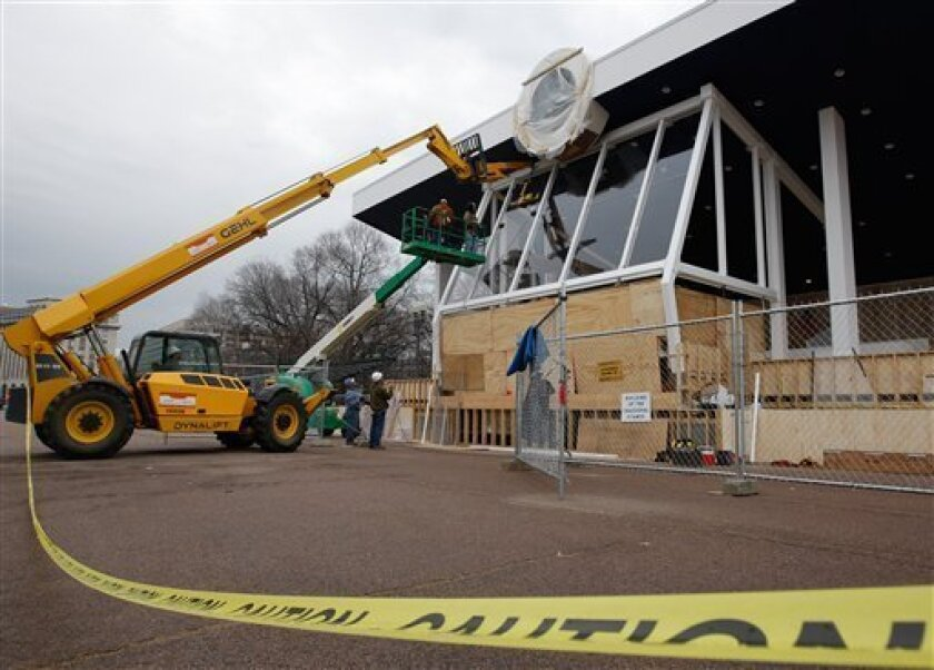 Workers put bulletproof glass on President-elect Barack Obama's Inaugural Reviewing Stand on Pennsylvania Avenue in front of the White House in Washington, Monday, Jan. 5, 2009. (AP Photo/Ron Edmonds)