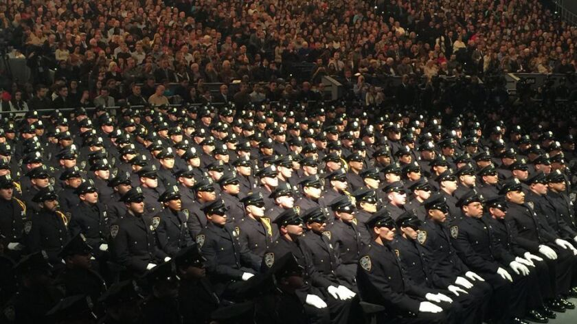 New recruits attend a graduation ceremony at Madison Square Garden.