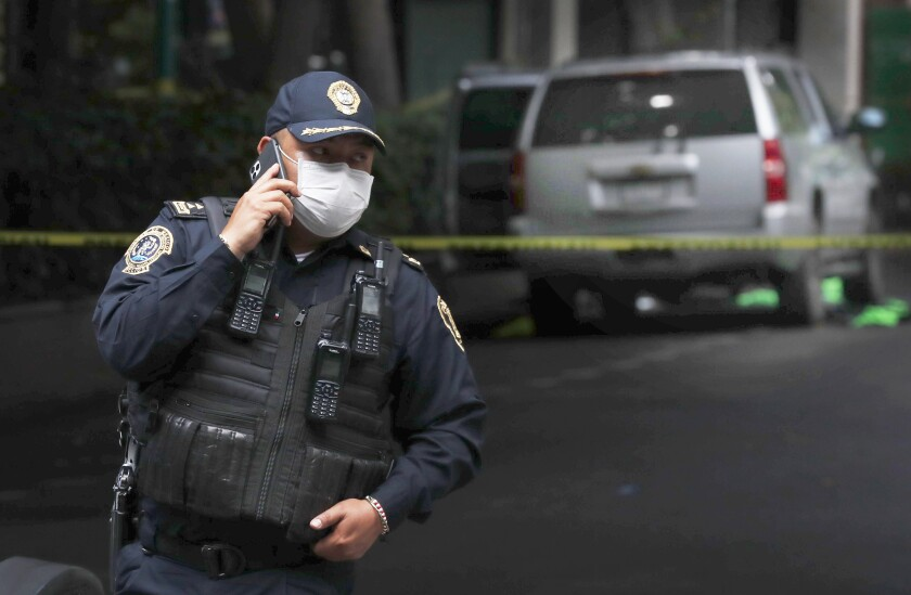 An abandoned vehicle that is believed to have been used by gunmen in an attack against Mexico City's police chief.