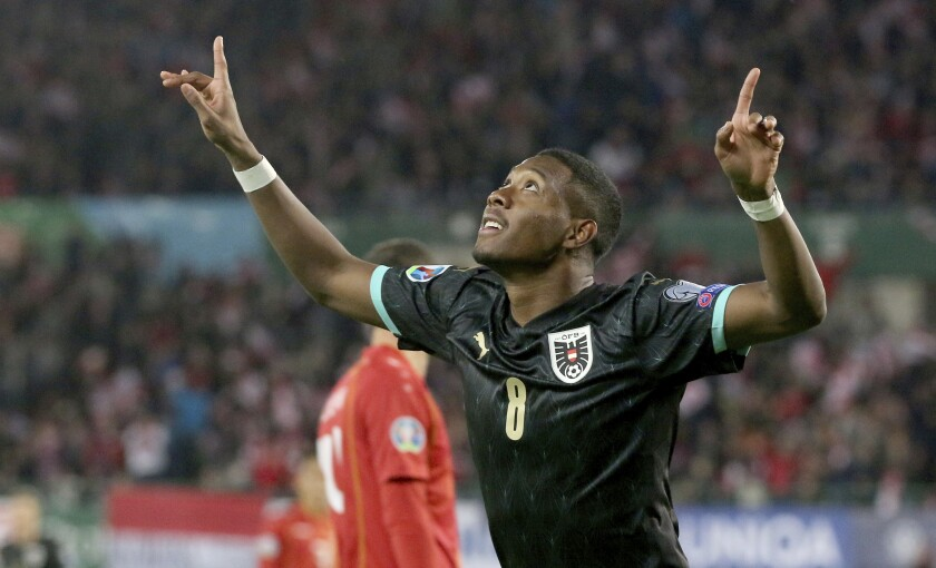 FILE - In this Saturday, Nov. 16, 2019 filer, Austria's David Alaba reacts after scoring during the Euro 2020 group G qualifying soccer match between Austria and North Macedonia at Ernst-Happel stadium in Vienna, Austria. (AP Photo/Ronald Zak)