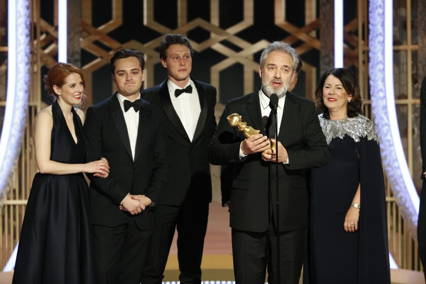 "Filmmaker Sam Mendes accepts the award for best motion picture drama for ""1917"" at the 77th Golden Globe Awards."