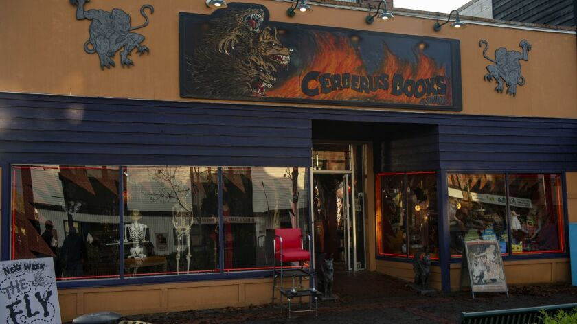 "An exterior photo of Cerberus Books and Spirits from ""Chilling Adventures of Sabrina."""
