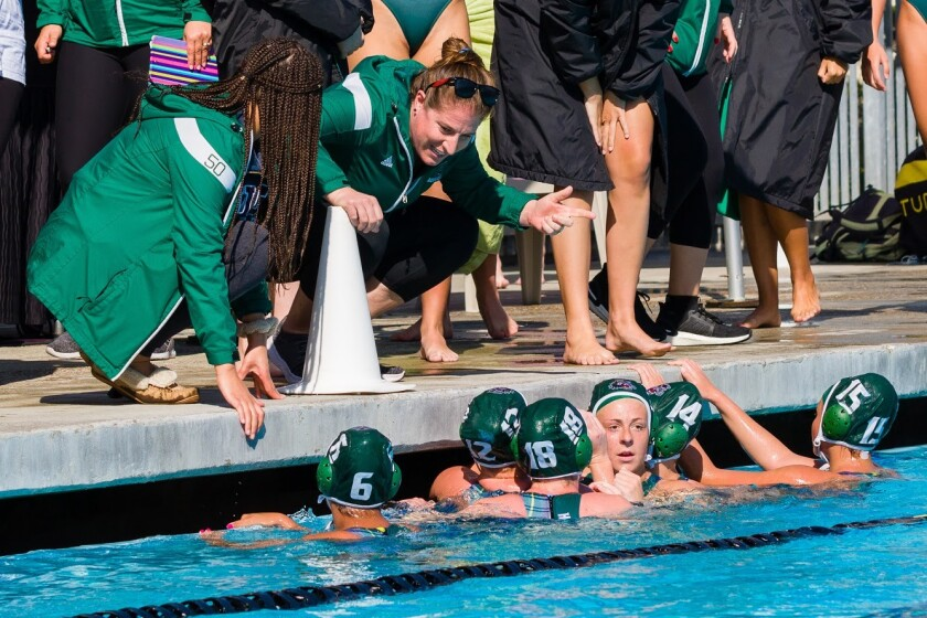Helix girls water polo coach Lenelle Wylie addresses the team during a playoff game against Poway in February at La Jolla High's Coggan Family Aquatic Center.
