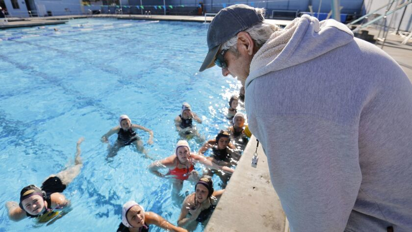 SAN DIEGO, CA 1/26/2018: Carlsbad High School girls varsity water polo coach Greg Horman talks with