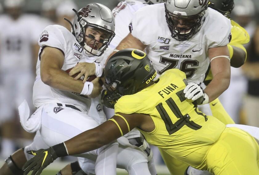 Oregon's Mase Funa sacks Montana quarterback Dalton Sneed during a game in September.