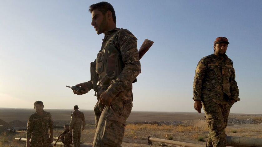 """""""We are fighting ISIS. They are fighting ISIS. Why are they fighting us?,"""" opposition fighter Ra"""