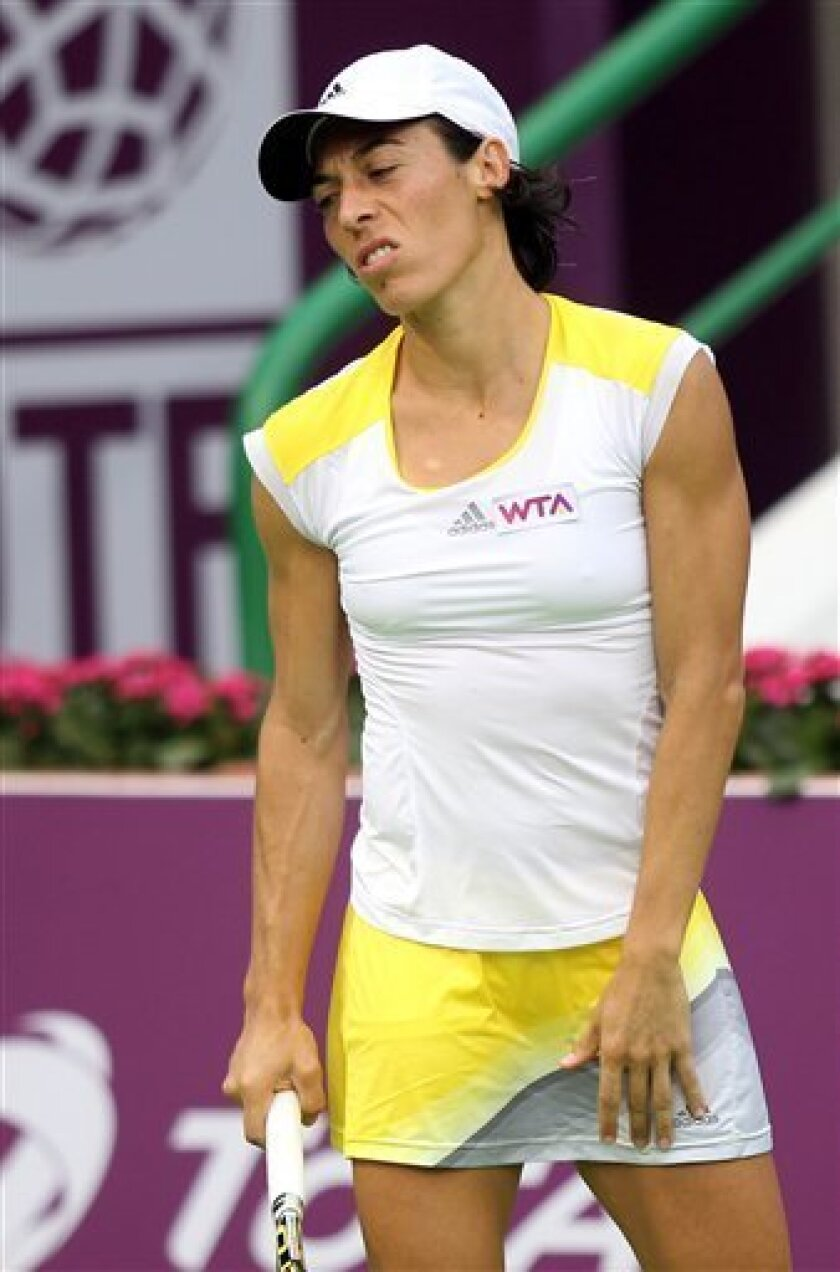 Francesca Schiavone of Italy returns the ball during her match against France's Marion Bartoli on the Second day of the WTA Qatar Ladies Open in Doha, Qatar, Tuesday, Feb. 12, 2013. (AP Photo/Osama Faisal)