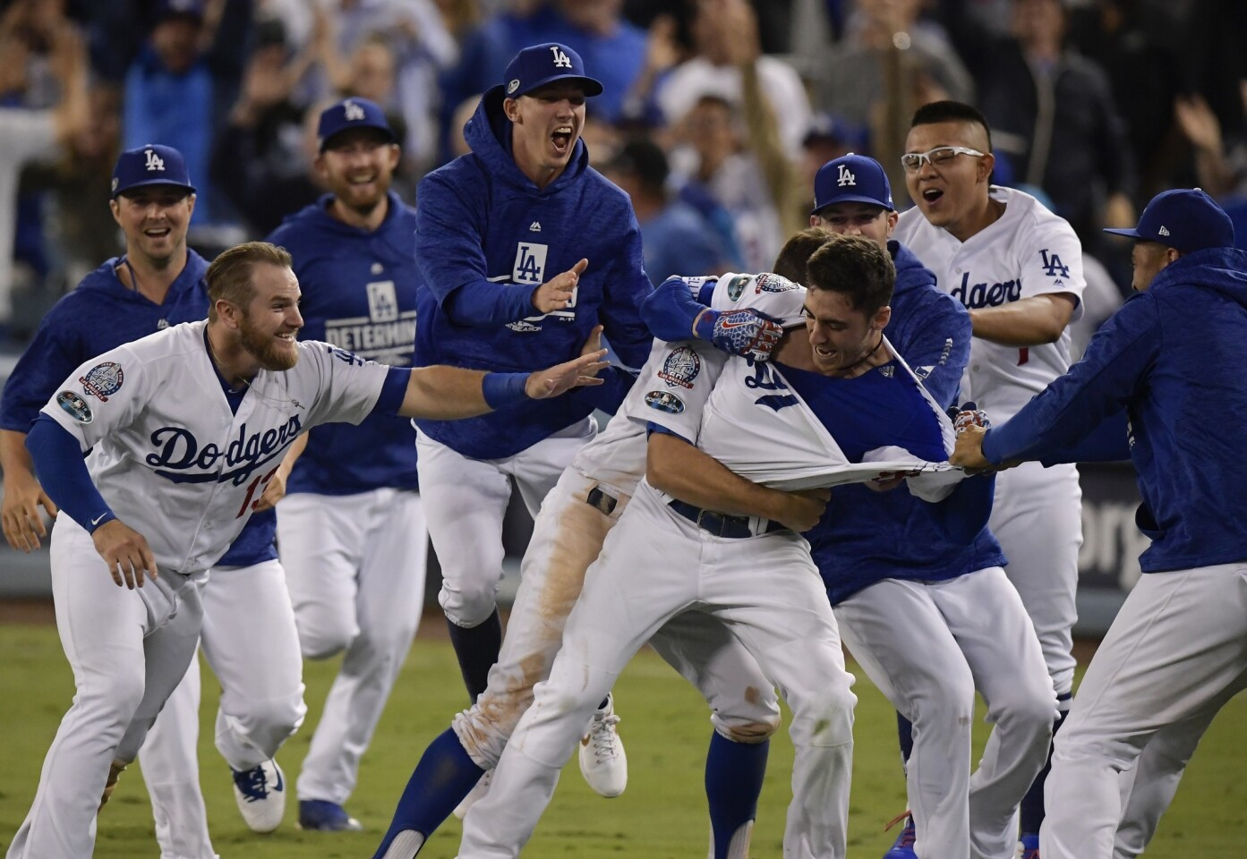 Los Angeles Dodgers' Cody Bellinger celebrates after hitting a walk-off hit during the 13th inning of Game 4 of the National League Championship Series baseball game against the Milwaukee Brewers Tuesday, Oct. 16, 2018, in Los Angeles. The Dodgers won 2-1 to tie the series at 2-2. (AP Photo/Mark J. Terrill)