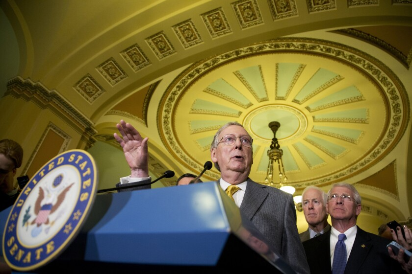 Senate Majority Leader Mitch McConnell (R-Ky.), center, said the Senate will again attempt to vote on the free-trade measure in coming days.