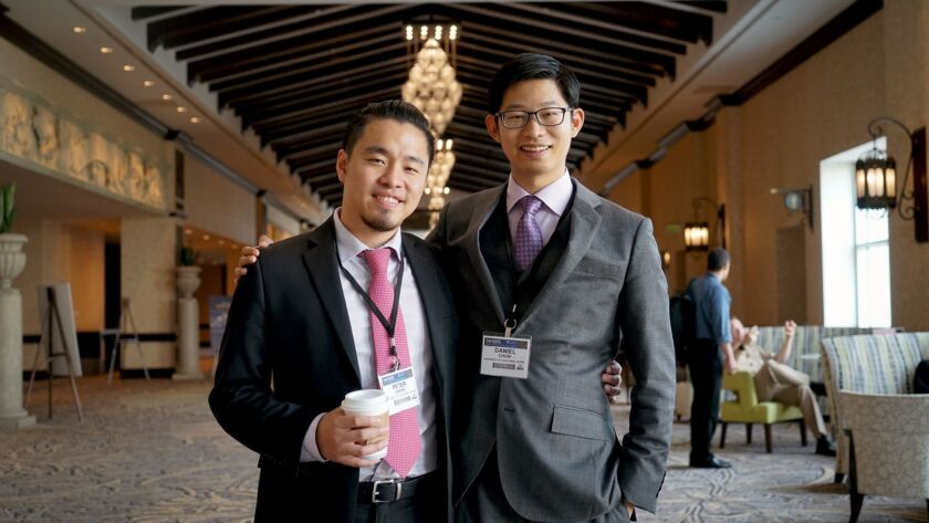 Peter Chang, left, and Daniel Chow are the co-directors of a new center at UC Irvine that seeks to unite artificial intelligence and medicine.