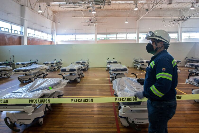 Workers convert the gym of the steel company Ternium into a field hospital for COVID-19 patients in Monterrey, Mexico.