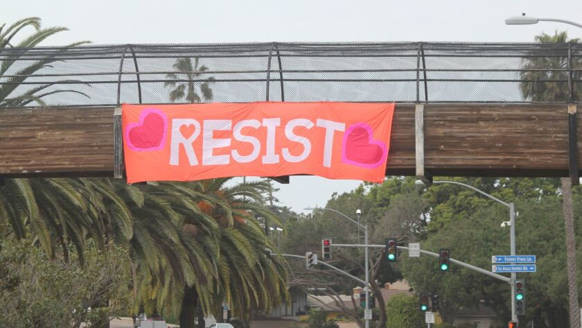 Following the first Solidarity Sundays San Diego Coastal Chapter meeting, members hung this 'Resist' banner across the Torrey Pines Road footbridge.