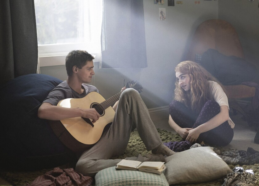 """Fin Argus' teen musician talks with his songwriting partner, played by Sabrina Carpenter, in the movie """"Clouds."""""""