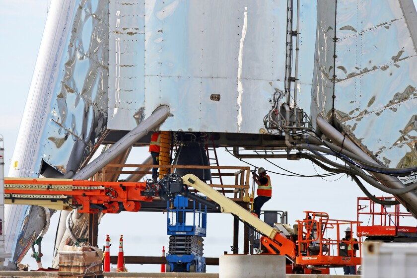 SpaceX engineers work on a Starship prototype at Boca Chica