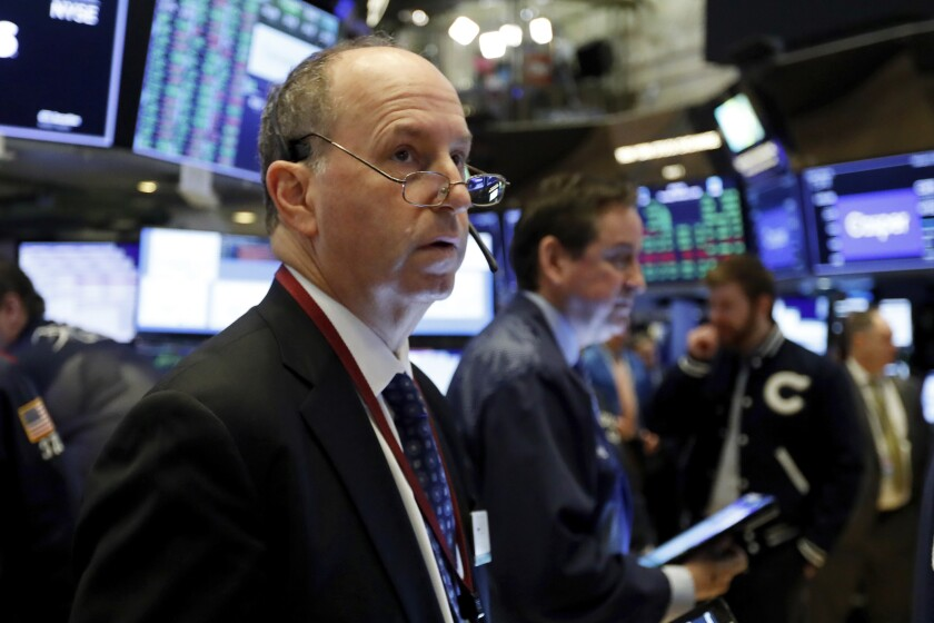 FILE - In this Feb. 6, 2020, file photo trader Gordon Charlop works on the floor of the New York Stock Exchange. The U.S. stock market opens at 9:30 a.m. EST on Thursday, Feb. 13. (AP Photo/Richard Drew, File)