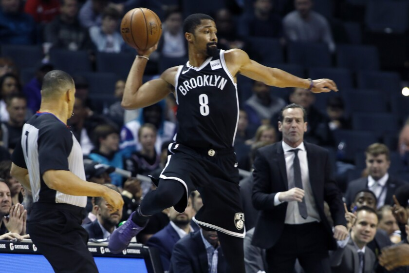Brooklyn Nets' Spencer Dinwiddie (8) looks for a teammate to pass the ball to as he goes out of bounds during the first half of an NBA basketball game against the Charlotte Hornets in Charlotte, N.C., Friday, Dec. 6, 2019. (AP Photo/Bob Leverone)