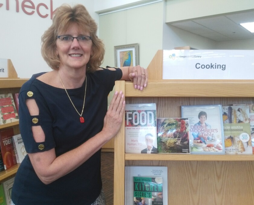Ramona Library Branch Manager Colleen Baker encourages readers to take advantage of free materials.