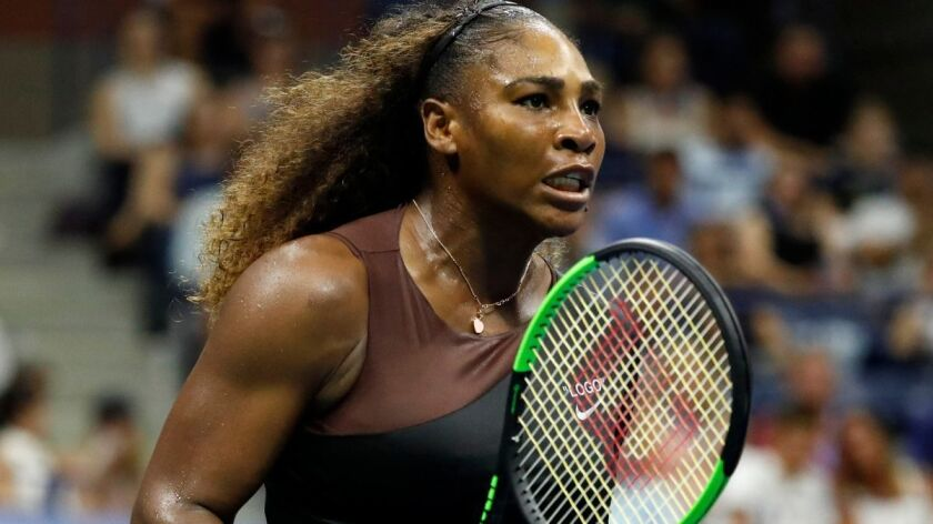Serena Williams reacts during her match against Karolina Pliskova during their US Open match on Tuesday in New York.