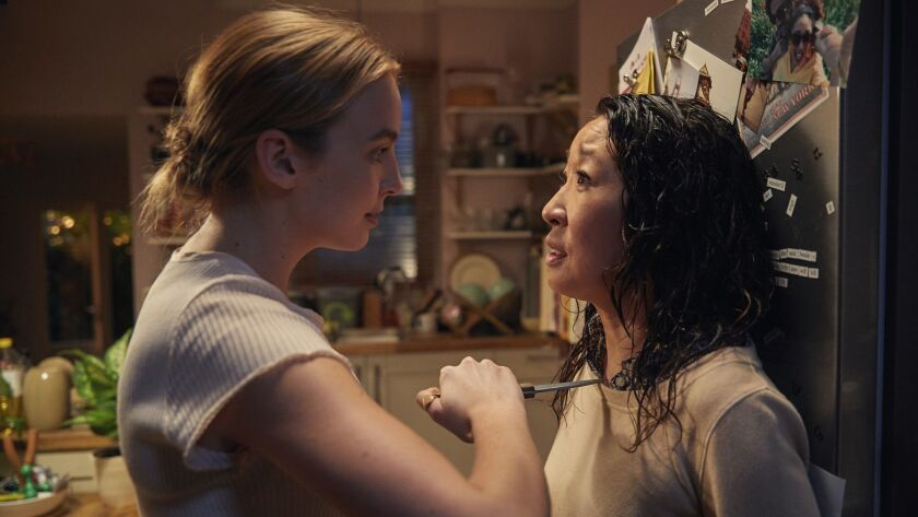 """Assassin Villanelle (Jodie Comer, left) and British agent Eve (Sandra Oh) come face to face and knife to throat in a scene from BBC America's """"Killing Eve."""""""