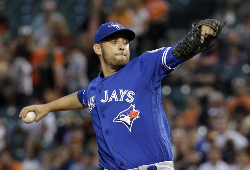 "FILE- In this April 21, 2016, file photo, Toronto Blue Jays starting pitcher Marco Estrada throws to the Baltimore Orioles during the first inning of a baseball game in Baltimore. Estrada has gone on the disabled list because of a sore lower back and will not play in the All-Star Game. ""My worst ni"