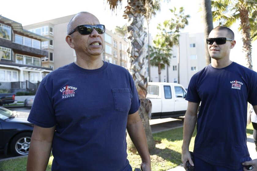 Firefighters Willie Blas (left) and Matt de los Cobos talk about their New Year's resolutions for 2015.