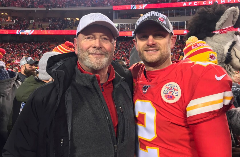 Craig Colquitt (left) and son Dustin enjoy a moment after the Chiefs' AFC championship victory.