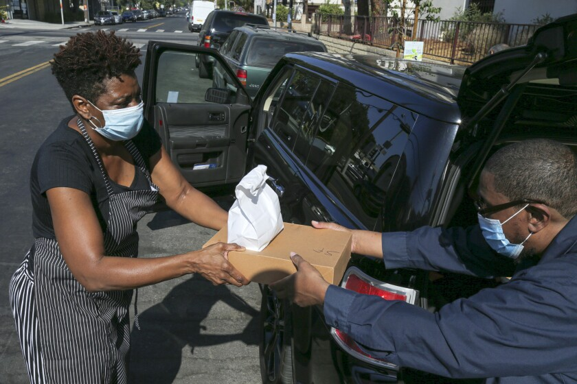 Jeanette Bolden-Picken delivers a pie to Clarence Ellis, a loyal customer from the L.A. neighborhood of Sylmar.