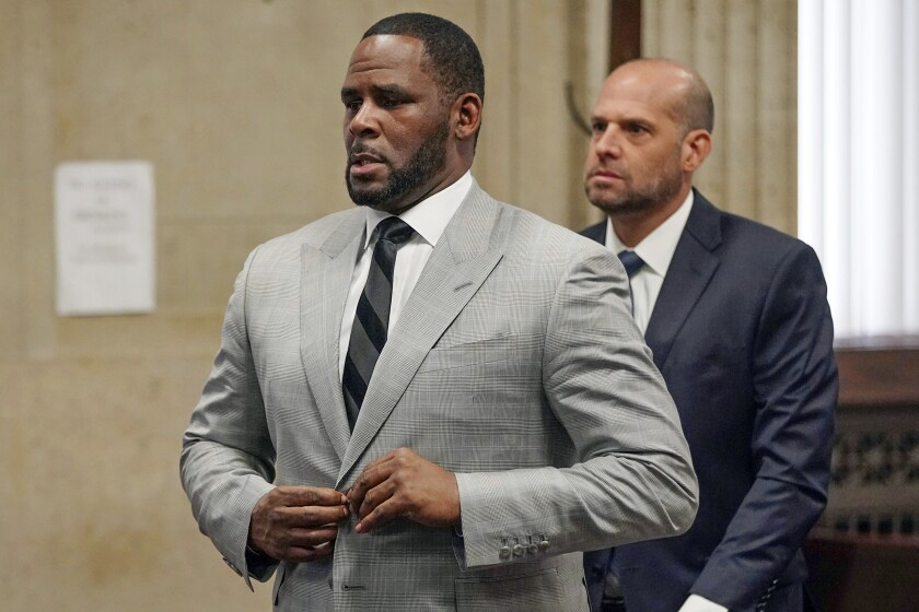 FILE - In this June 6, 2019, file photo, singer R. Kelly pleaded not guilty to 11 additional sex-related felonies during a court hearing before Judge Lawrence Flood at Leighton Criminal Court Building in Chicago. R&B singer R. Kelly is due in federal court to enter a plea to an updated federal indictment that includes sex abuse allegations involving a new accuser. The 53-year-old is expected to plead not guilty at a hearing Thursday, March 5, 2020, in Chicago to a superseding indictment unsealed last month that includes multiple counts of child pornography. (E. Jason Wambsgans/Chicago Tribune via AP, Pool, File)
