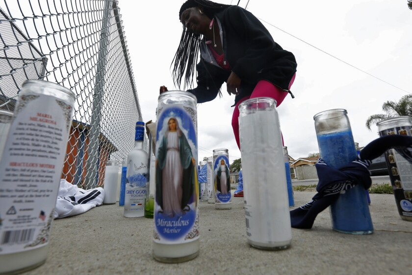 Trecie Bryant visits a memorial for a shooting victim in Compton.