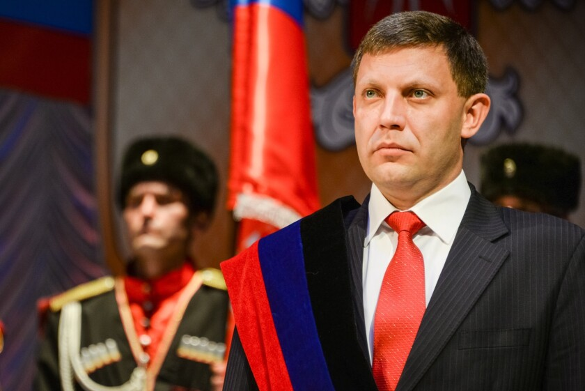 Ukrainian secessionist leader Alexander Zakharchenko is sworn in as prime minister of the so-called People's Republic of Donetsk on Nov. 4.