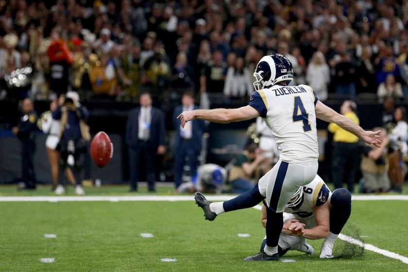 Greg Zuerlein kicks a field goal against New Orleans.