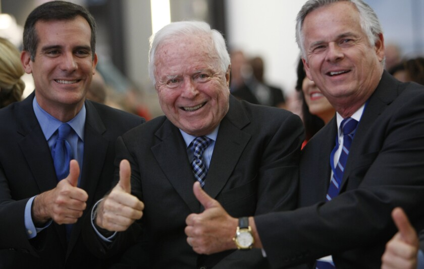 Los Angeles Mayor Eric Garcetti , left, with former mayors Richard Riordan and James Hahn in 2013 at the grand opening of the $1.9-billion Tom Bradley International Terminal at LAX. Riordan has come out in support of a measure to crack down on mega-developments across the city.