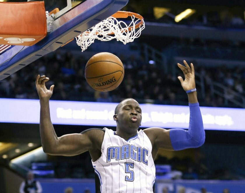 Orlando Magic's Victor Oladipo (5) dunks the ball against the San Antonio Spurs during the first half of an NBA basketball game, Wednesday, Feb. 10, 2016, in Orlando, Fla. (AP Photo/John Raoux)