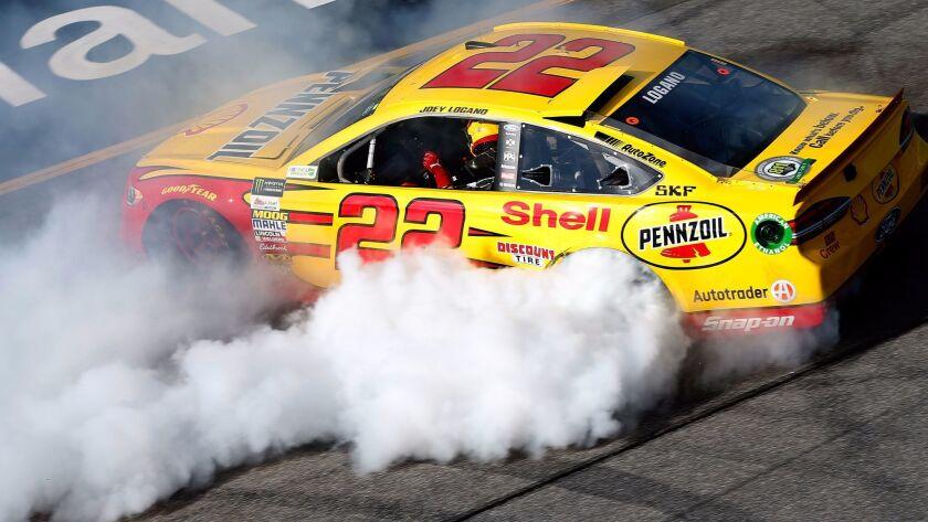 RICHMOND, VA - APRIL 30: Joey Logano, driver of the #22 Shell Pennzoil Ford, celebrates after winni