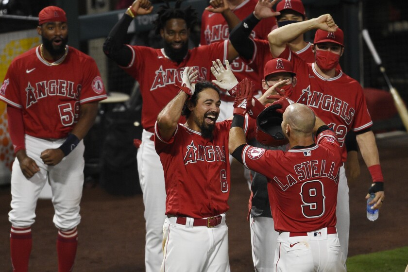 Angels' Tommy La Stella, right, celebrates with Anthony Rendon at home plate.