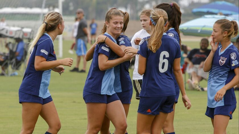 San Diego Soccer Club's Leiden Huber (center) is hugged by a teammate after her first-half goal.