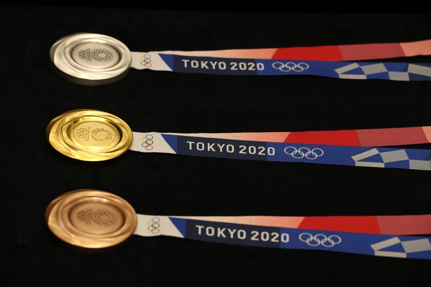 Medals for the Tokyo 2020 Olympic Games are displayed.