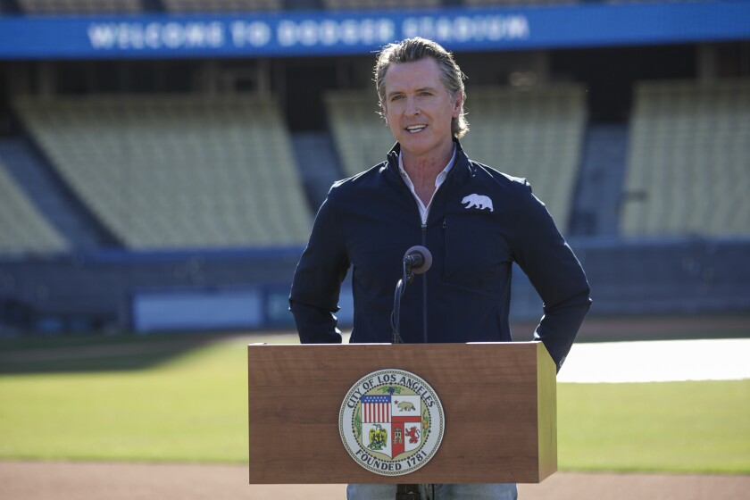 Gov. Gavin Newsom holds a news conference at the launch of COVID-19 vaccinations at Dodger Stadium on Jan. 15.
