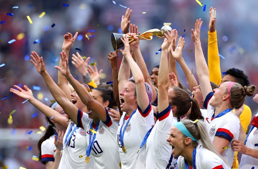 Megan Rapinoe of the USA lifts the FIFA Women's World Cup Trophy following her team's victory in final against the Netherlands on Sunday in Lyon, France.