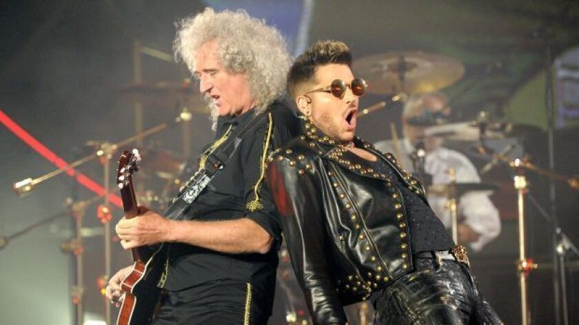 Adam Lambert, right, performs alongside Brian May of Queen during their concert at The Forum in Los