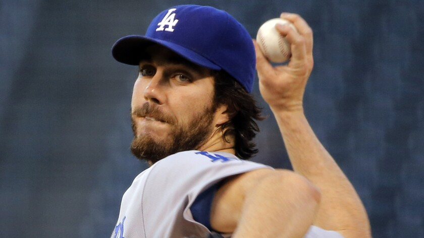 Dodgers starter Dan Haren delivers a pitch during the first inning of a 10-4 loss to the Colorado Rockies on Tuesday.